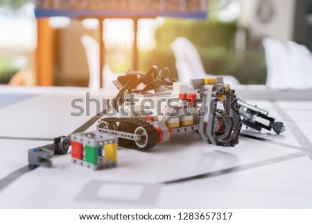 Stem educations,inventor school Creating robotics project,School boys planning of innovation robot model in laptop,microcontroller Circuit board Analysis assembly,DIY robot in science education class #1283657317