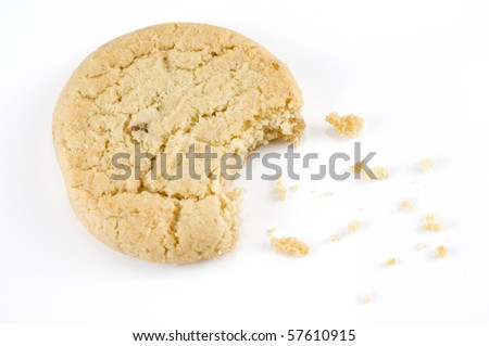 Stem ginger cookie with a bite out of it on a white background