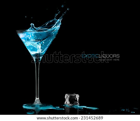 Stemmed cocktail glass with blue alcoholic drink splashing out, close-up isolated on black. Template design with sample text #231452689