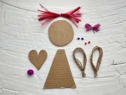 Step by step how to make a doll for a child from a simple material, cardboard recycling.