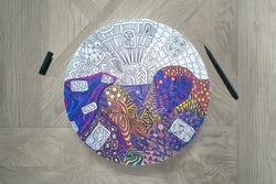 Step-by-step instructions for DIY round wall clock in zentangle technique: step 4.2- close up of draft coloring process,contour liner.Part-finished drawing of curls,geometric shapes,triangles,bubbles