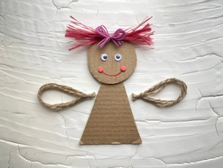 Step by step, learning how to make an angel doll out of cardboard