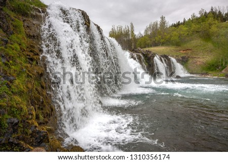 Step of a small waterfall with many streams of water