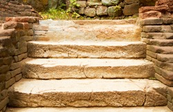 step stone staircase in the ruins of the ancient cave city, old stairs close up, Stone staircase with plants in a medieval city with cobblestone