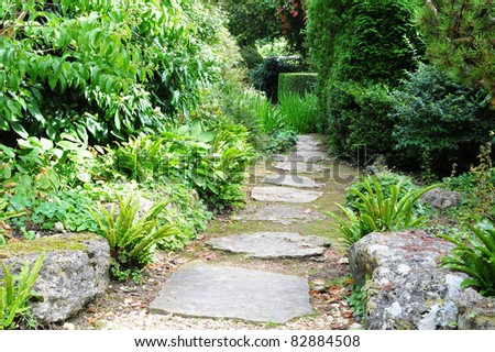 Stepping Stone Path in a Peaceful Green Garden - Low Angle View with a Shallow Depth of Field