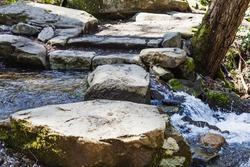 stepping stones across mountain stream