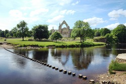 Stepping stones over the river Wharfe at Bolton Abbey, North Yorkshire, UK