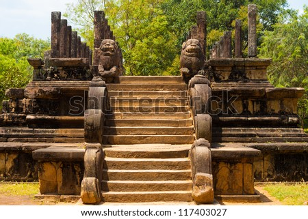 Steps and lion carvings lead to the ancient audience hall, part of the ruins of the former capitol in Polonnaruwa, Sri Lanka