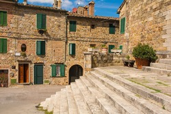 Steps of the Parish Church in the medieval town of Monticiano in Siena Province, Tuscany, Italy. The church is the Parrocchia e Chiesa di Santi Giusto e Clemente - Church of Saints Justus and Clements
