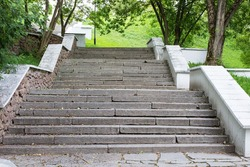 Steps of the stairs in the city park. Horizontal. Selective focus.