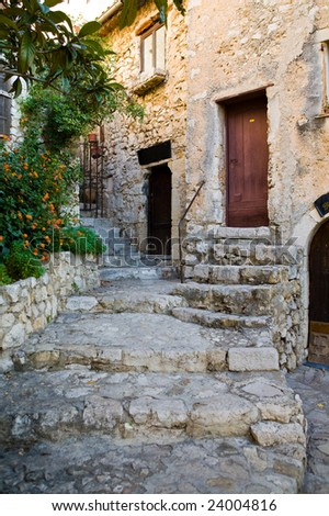 Steps on a street and doors in the medieval city of Exe, France, which is a fortress, built on cliff-side hill