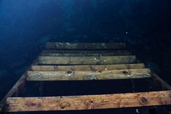 steps under water. The staircase below is hidden under the water. Lake emptied the stairs. Reflection. deeply drowned down