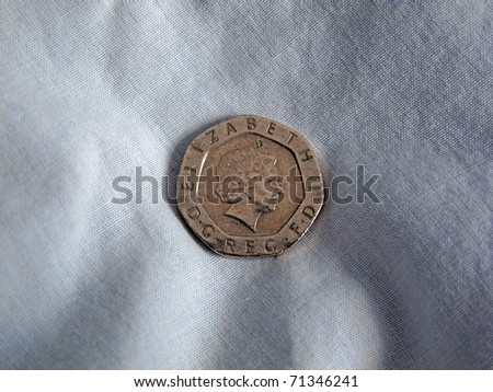 Sterling 20p coin on linen