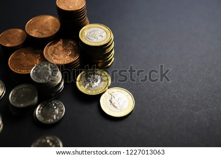 Sterling pound money savings on a studio background #1227013063