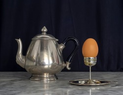 Sterling Silver Eggcup and Teapot Black Background Still Life