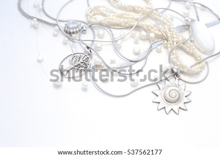 Sterling Silver jewelry on a white background, pearls Stock photo ©