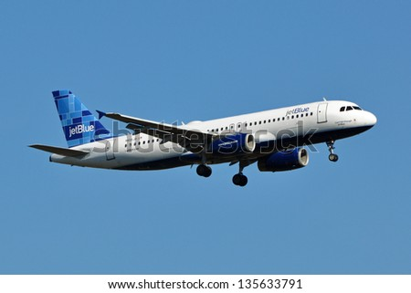 STERLING, USA - NOVEMBER 9, 2011: A JetBlue Airbus A320 lands at Washington Dulles International Airport. JetBlue Airways is an American low-cost airline which is headquartered in New York City.