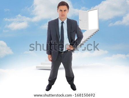 Stern businessman standing with hand on hip against steps leading to open door in the sky