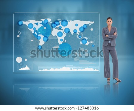 Stern businesswoman standing against a futuristic screen with the world map - stock photo