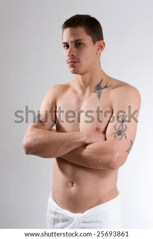 stock photo : stern looking young man with tattoos