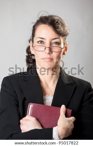 Stern Sunday school teacher with her bible