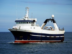 Stern Trawler underway at sea to fishing grounds.
