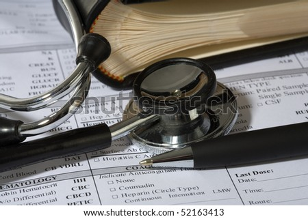 Stethoscope, a pen and a blank prescription pad