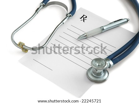Stethoscope, a pen and a blank prescription pad on white background