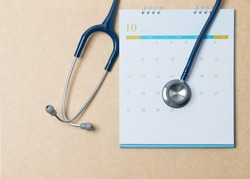 Stethoscope and a calendar. Doctor's appointment and service in the hospital.