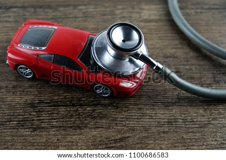 Stethoscope and car on the wooden background, Concept of car check-up, repair and maintenance. #1100686583