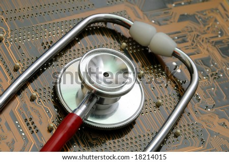 Stethoscope and circuit board - stock photo
