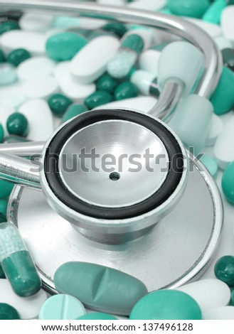 stethoscope and colored pills