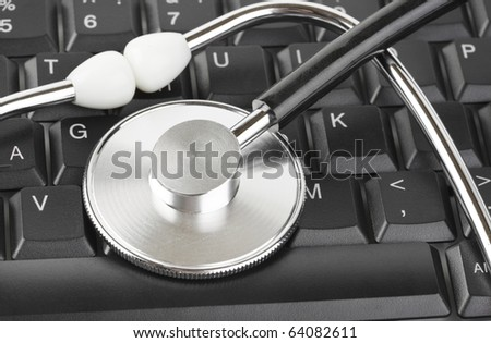 Stethoscope and computer keyboard - technology background
