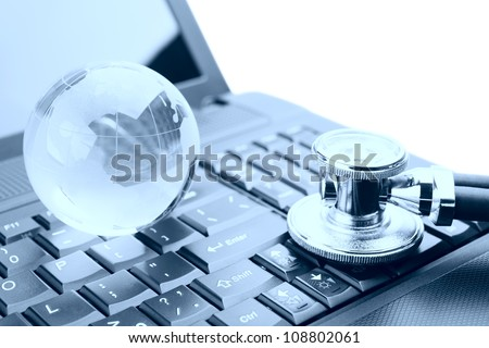 Stethoscope and globe on a laptop keyboard