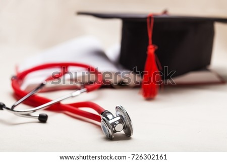 Stethoscope and graduate hat.