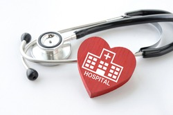 Stethoscope and heart object with hospital pictogram