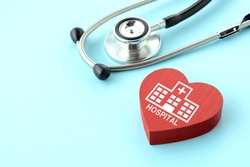 Stethoscope and heart object with hospital pictogram on light blue background