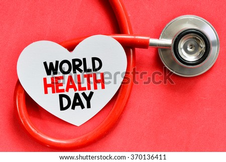 Stethoscope and heart symbol with inscription World Health Day on red background
