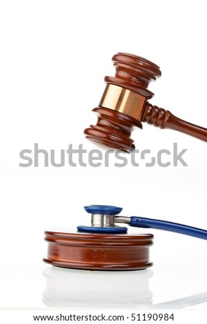 Stethoscope and judges hammer as a symbol for medical mistakes
