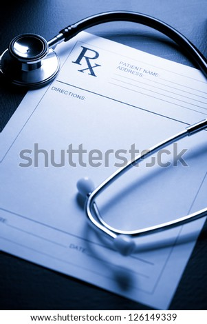 Stethoscope and patient list on black