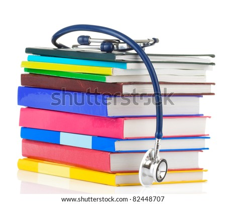 stethoscope and pile of books isolated on white background