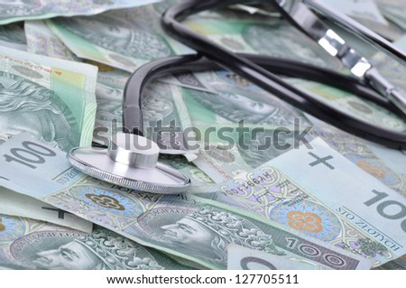 stethoscope and polish banknotes in background