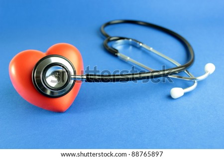 Stethoscope and red heart - stock photo