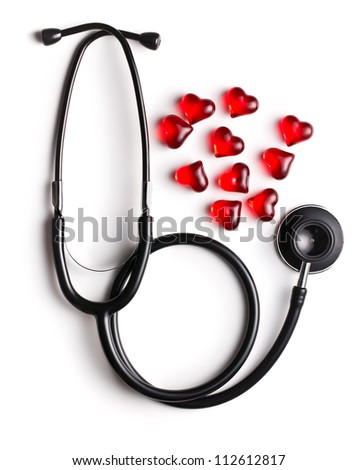 stethoscope and red hearts on white background