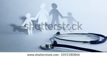 stethoscope and the family paper doll.the concept of health.
