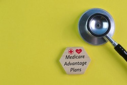Stethoscope and wooden block with text MEDICARE ADVANTAGE PLANS