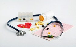 Stethoscope, cardiogram, vitamins for health and medical examination on the table. Health care concept.