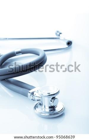 stethoscope closeup on white background - stock photo