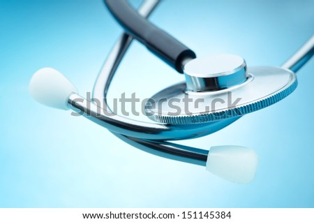 Stethoscope detail on blue background