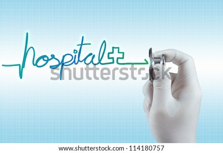 Stethoscope in hand with hospital word as medical concept